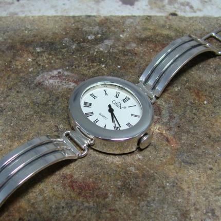 Dorobienie koperty srebrnego zegarka.