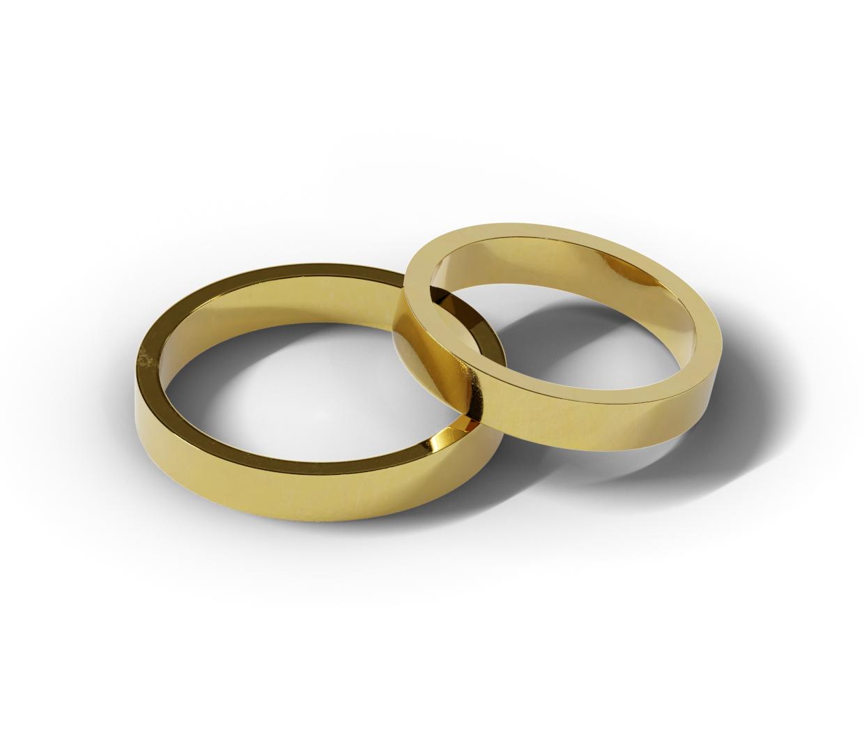 Klasyczne obrączki ślubne zrobione z żółtego złota.