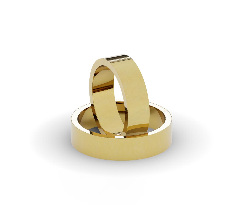 Płaskie obrączki ślubne z żółtego złota.