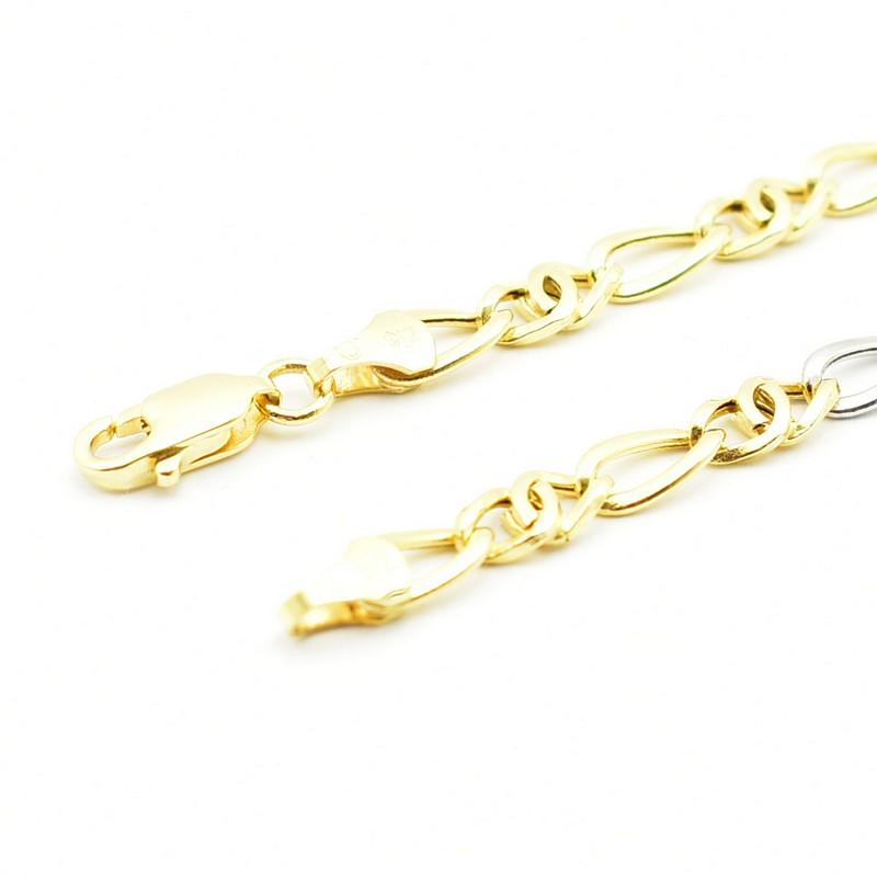 Dęty łańcuszek z żółtego i białego złota.