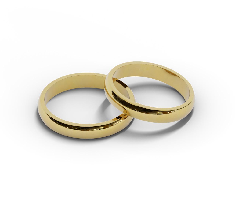 Para półokrągłych obrączek ślubnych z żółtego złota.