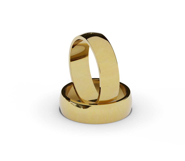 Klasyczne, złote obrączki ślubne, półokrągłe.