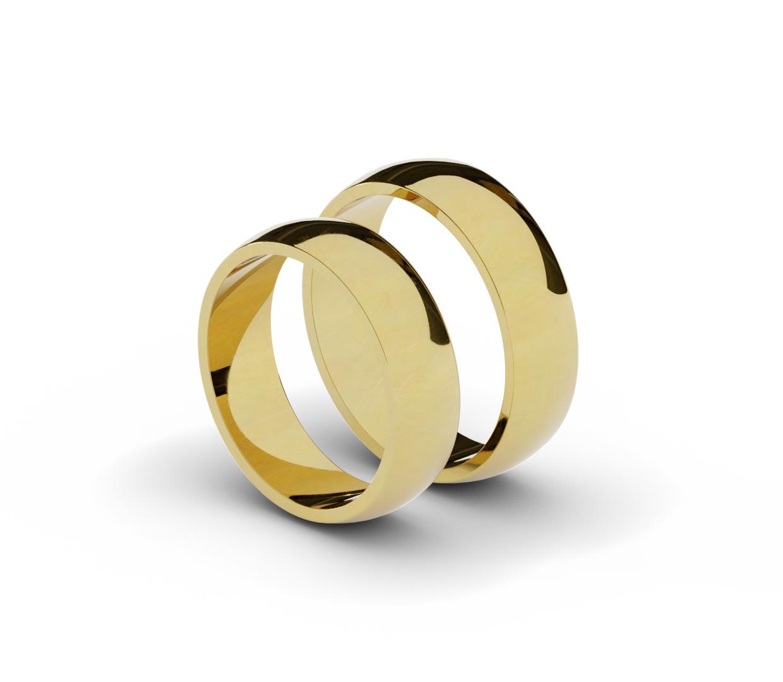 Para klasycznych, półokrągłych obrączek ślubnych.