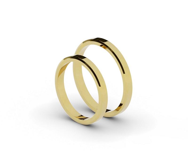 Złote obrączki ślubne o szerokości 2,5 mm.