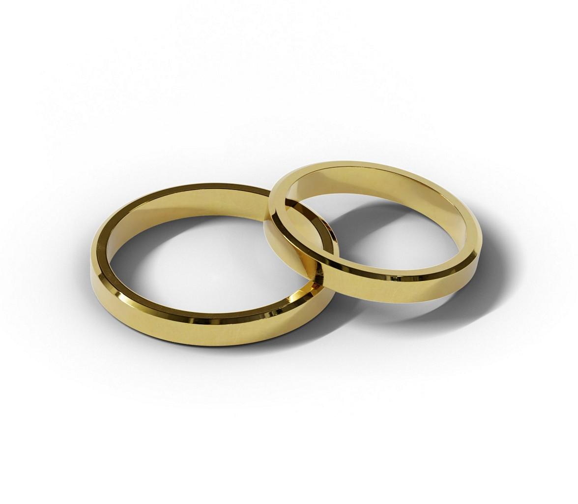 Para złotych obrączek ślubnych.