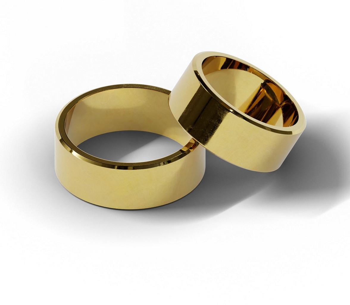 Para klasycznych obrączek ślubnych z żółtego złota.