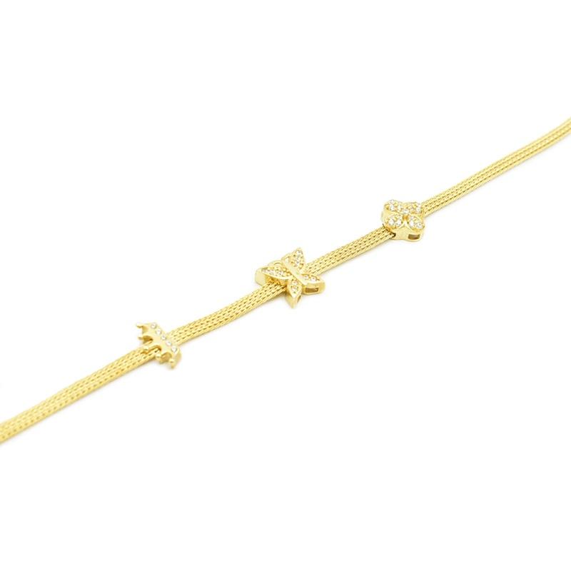 Przekładki z cyrkoniami na złotej bransoletce.