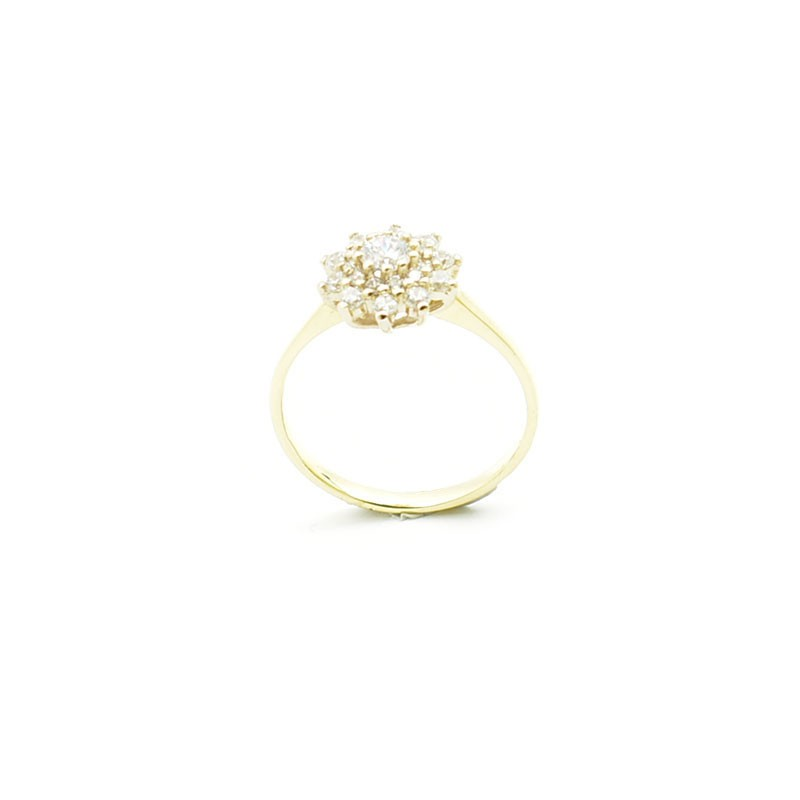 Złoty pierścionek z cyrkonia.